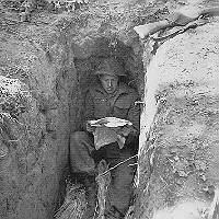 soldier relaxes in a slit-trench